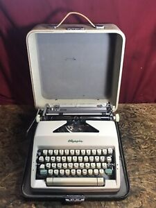 Vintage 1964 Olympia Portable Typewriter w/Turquoise Emblem Made in West Germany