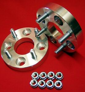 1-034-BILLET-WHEELS-SPACERS-Ford-Mustang-4-lug-MACHINED-1-2x20-studs-and-nuts