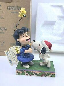 Jim-Shore-Peanuts-Mistletoe-Mischief-Lucy-Snoopy-Figurine