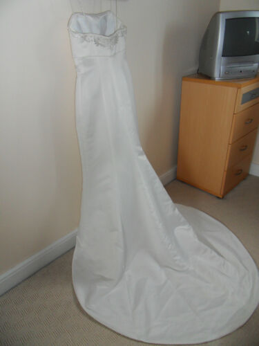 Simple but beautiful Empire line cream Wedding dress with small train and wrap