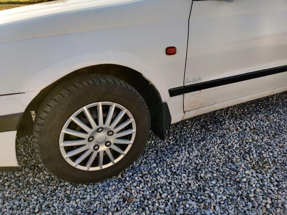 Toyota Carina E, 1,6 XLi Fantastic, Benzin