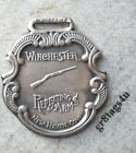 Winchester Repeating Arms silver plated watch fob