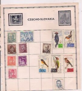 14 CZECHOSLOVAKIA + 4 DOMINICA stamps on an album page.