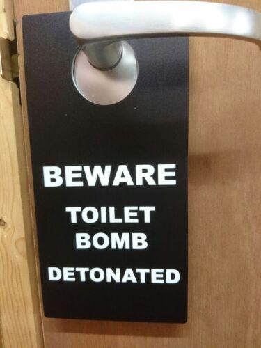 BEWARE TOILET BOMB DETONATED comedy toilet door hanger sign
