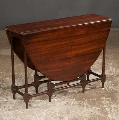 Sheraton style mahogany gate leg table with oval shape drop leaves and... Lot 27
