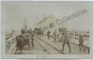 C1910-RP-POSTCARD-SEMAPHORE-JETTY-WITH-SHEDS-AND-PEOPLE-WALKER-PHOTO-C19
