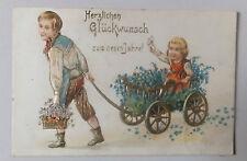 AK  Neujahrskarte geprägt Kinder Junge Mädchen mit Leiterwagen  gel. 1906