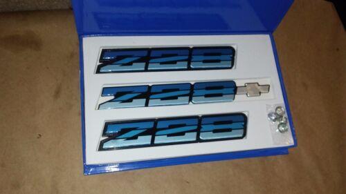 82-90 CAMARO Z28 BLUE EMBLEM SET TRI COLOR REAR BUMPER AND ROCKER PANEL NEW
