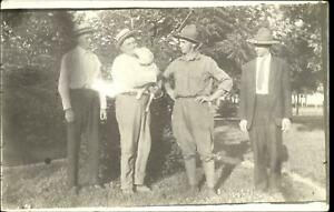 RPPC-man-gets-kiss-from-white-dog-also-Soldier-Ranger-real-photo-1910-1930