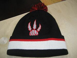 681e4d9bc94 MENS TORONTO RAPTORS Mitchell   Ness Winter BEANIE POM HAT BLACK OUT ...