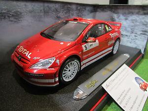 PEUGEOT-307-WRC-RALLYE-5-GRONHOLM-rouge-au-1-18-MAISTO-38693-voiture-miniature