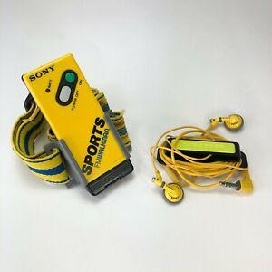 Vintage-Sony-Sports-FM-Walkman-Stereo-Receiver-w-Headphones-amp-Armband-Yellow