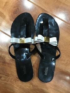 40441c1f9 Melissa Garden Black Jelly Flip Flops Sandals with Off white bow ...