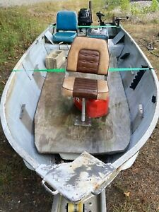 2012 9.9 Hp mercury 4 stroke outboard with older 14' aluminum boat and trailer