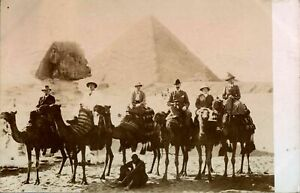 Antique-RPPC-photograph-postcard-English-tourists-on-camels-pyramids-Egypt