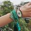 MIYUKI-Bracelet-Evil-Eye-Bracelet-Hamsa-Hand-Green-Crystal-Tassel-Handmade thumbnail 1