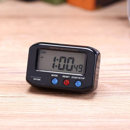 Small LCD Digital Time /& Date Alarm Clock Stop Snooze Night Light Clock