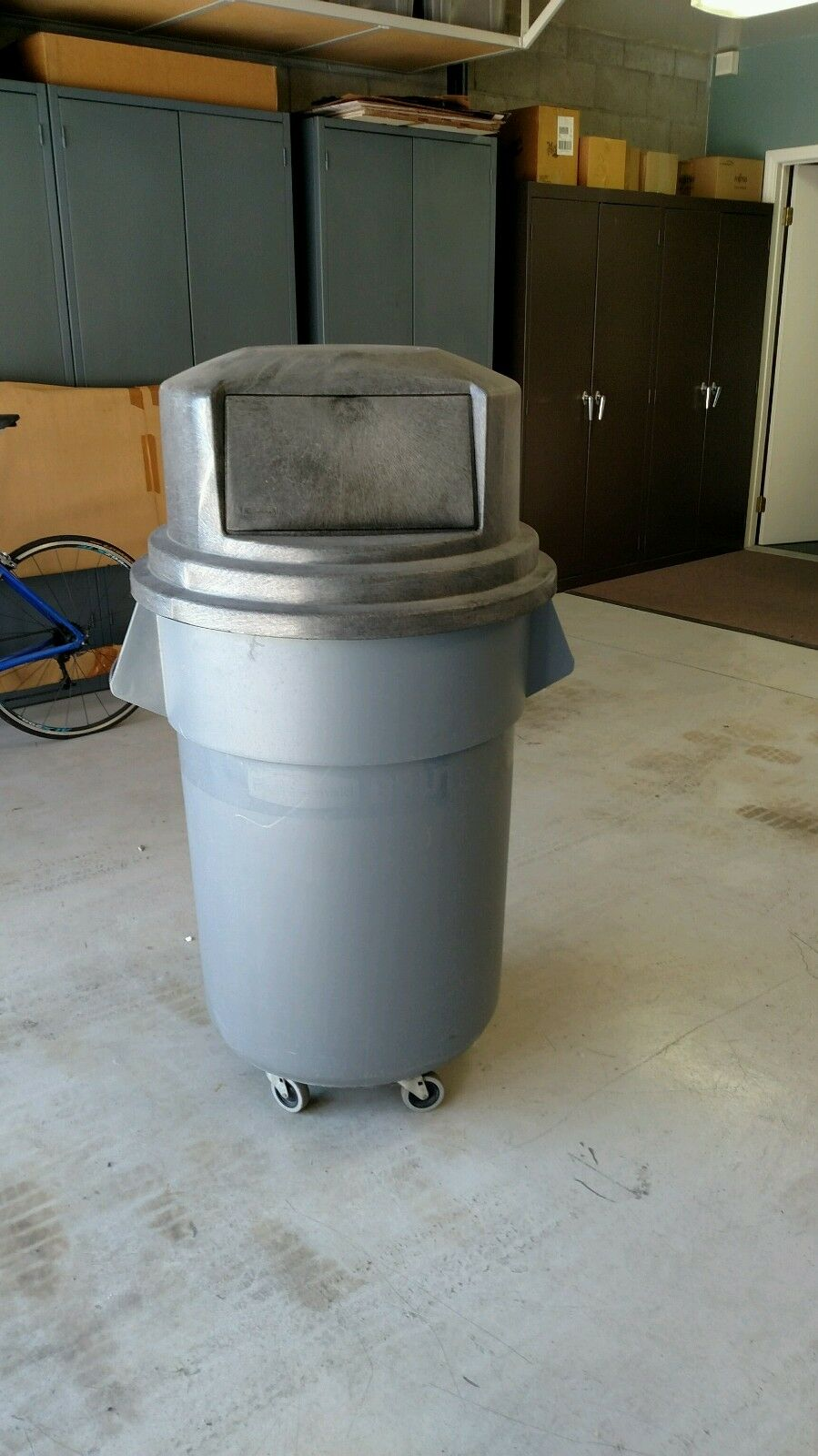 Rubbermaid BRUTE 55 Gallon Waste Container with wheeled dolly and dome lid
