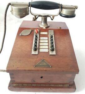 antiguo-Telefono-de-sobremesa-de-madera-anos-30-de-antiguo-palacete