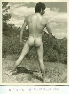 Nude-man-posing-outdoors-vintage-gay-interest-photo
