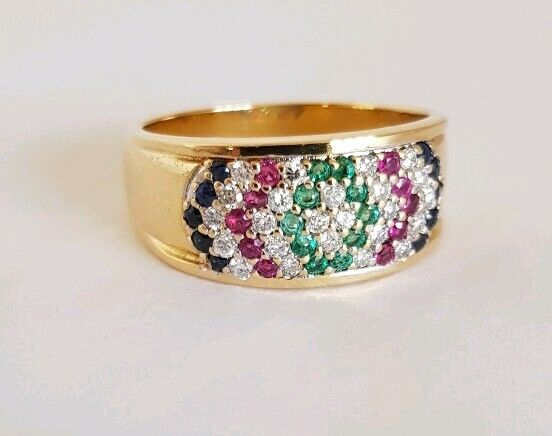 A 14 ct Yellow gold Dress Ring. Channel set to the center with  uniform Rubies
