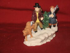 Rite Aid-Father & Son and dog bring home their Christmas Tree Figurines