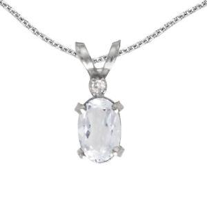 "10k White Gold Oval White Topaz And Diamond Filigree Pendant with 16"" Chain"