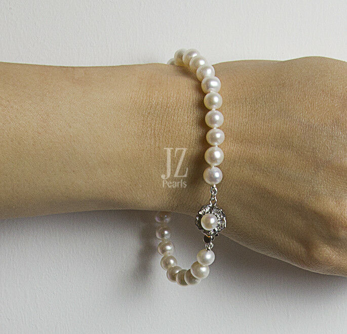Freshwater Cultured Pearl Bracelet with Pearl Flower Clasp & S S Stud Earrings.