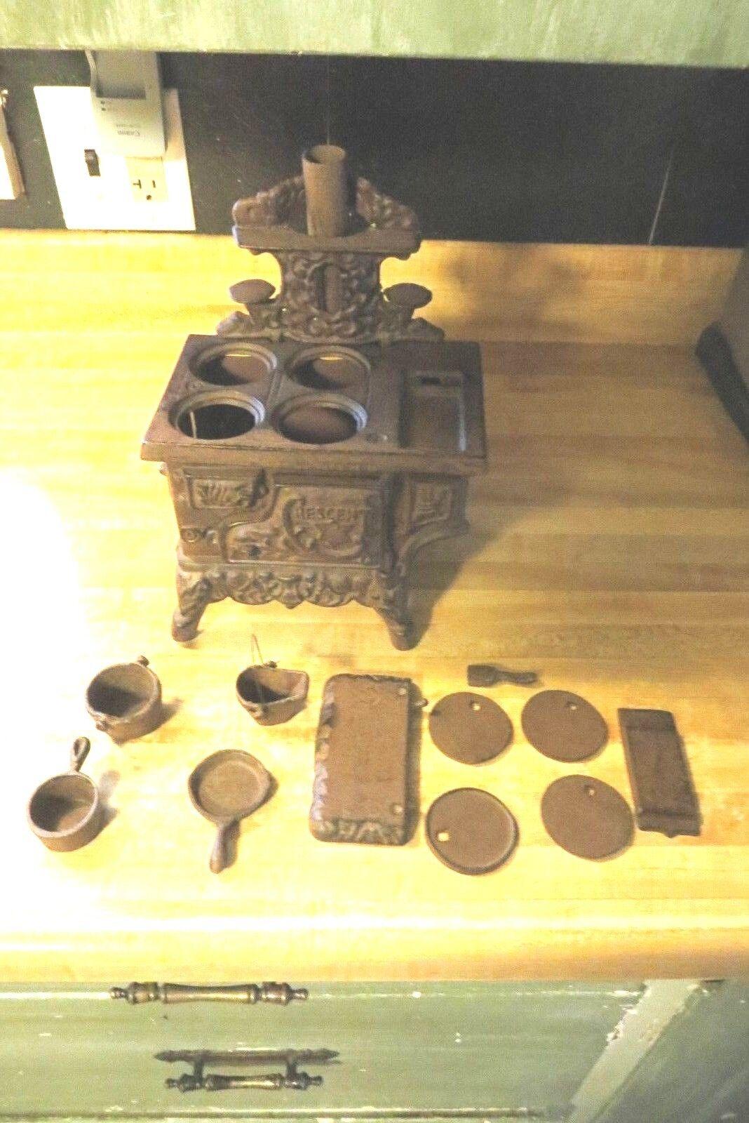 Salesmen sample cast iron stove & pots pans lids stove pipe burners side warmer
