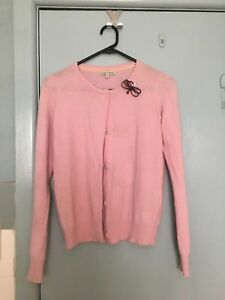 Laura-Ashley-pink-cardigan-with-red-brooch-in-size-S