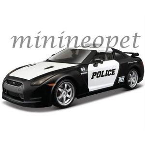 MAISTO-32512-2009-NISSAN-SKYLINE-GT-R-R35-POLICE-CAR-1-24-DIECAST-BLACK-WHITE