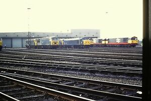 1-58-A-selection-of-Diesels-sat-outside-their-shed-Kodachrome-Slide
