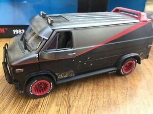 GREENLIGHT-84112-GMC-VANDURA-A-TEAM-VAN-Weathered-version-bullet-holes-1-24th