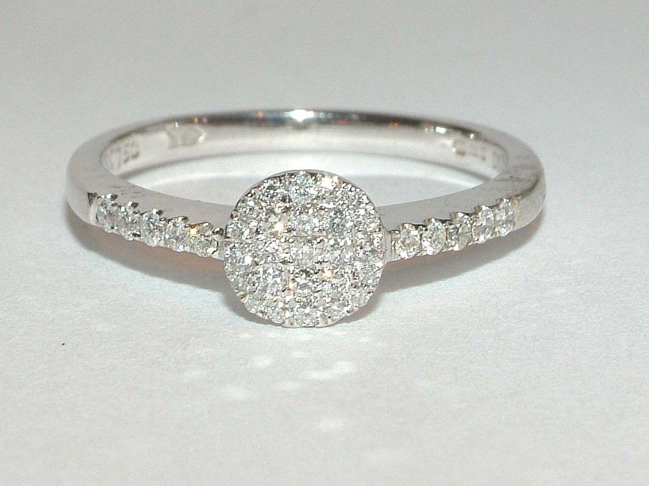 18 Carat w gold 0.33 carat diamond cluster ring with side diamonds