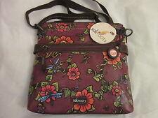 The Sak sakroots peace crossbody purse berry