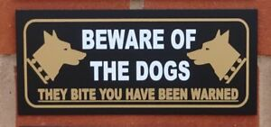 Beware-of-the-dogs-they-bite-you-have-been-warned-sign-All-Materials