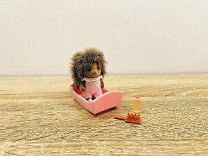 Sylvanian-Families-Bramble-Hedgehog-Family-Peaches-Hazel-Baby-Crib