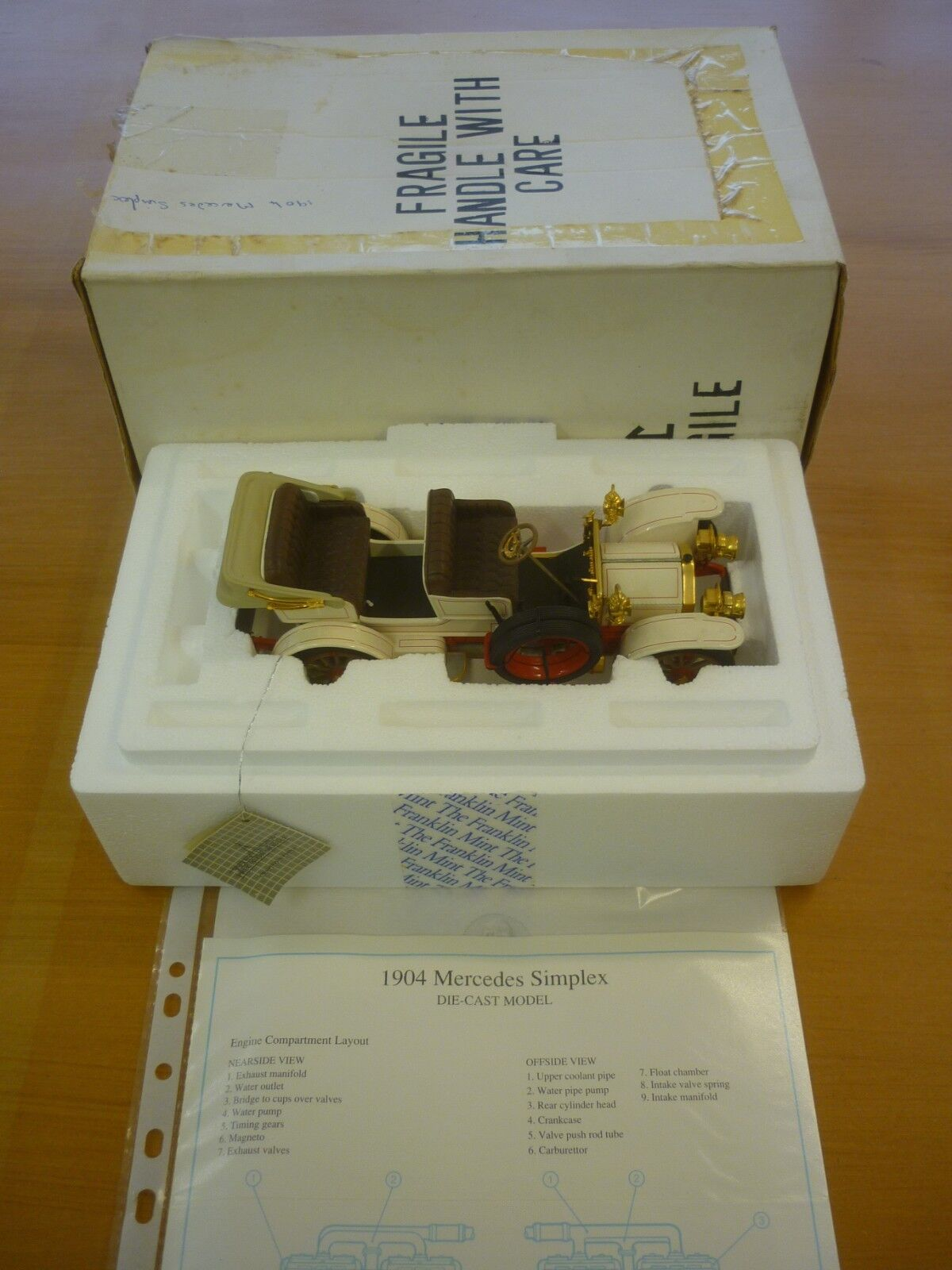 A Franklin mint scale model of a 1904 Mercedes Benz Simplex,  paperwork, boxed