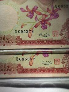 Singapore 1st series 10dollars orchid TQG 45 2pcs running rare