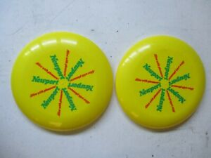 Two-Newport-Alive-With-Pleasure-Yellow-Frisbees