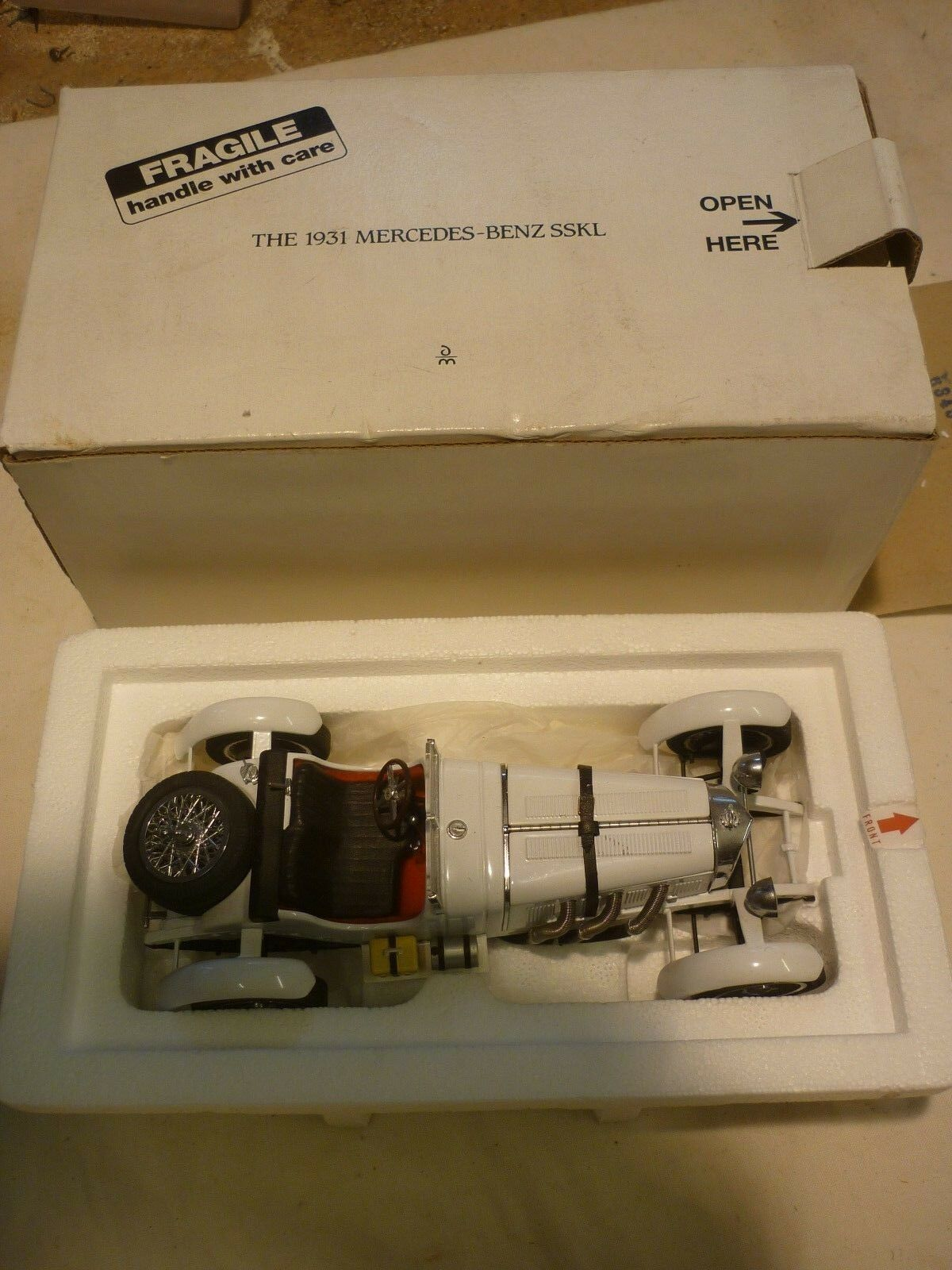 A Danbury mint scale model of a 1931 Mercedes Benz SSKL.  boxed