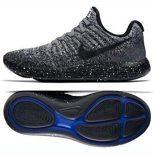 c53fc3e689e87 Nike W LunarEpic Low Flyknit 2 Black Racer Blue 863780-041 Women s ...
