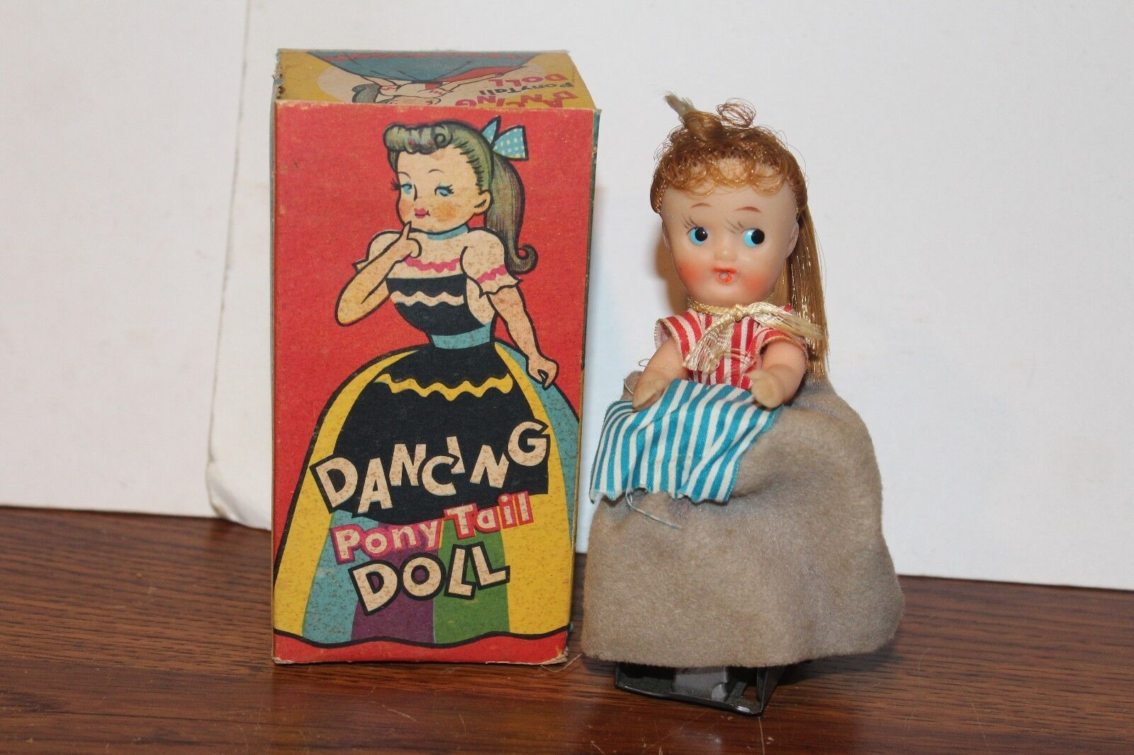 NICE VINTAGE WIND UP  DANCING PONY TAIL GIRL in BOX