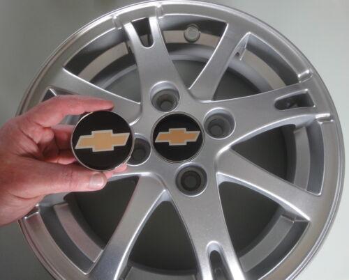 Conjunto de 4 nuevos casquillos de centro centrecaps /'ciudad/' Chevrolet Spark Ruedas de Aleación