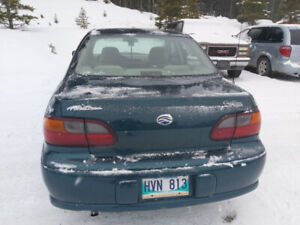 2000 Chevrolet Malibu V6 4 Door, 6 Cylinder. Green sedan.