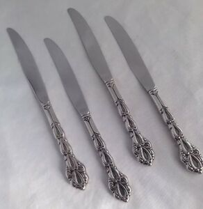 4 oneida chandelier dinner knives community betty crocker stainless image is loading 4 oneida chandelier dinner knives community betty crocker aloadofball Choice Image