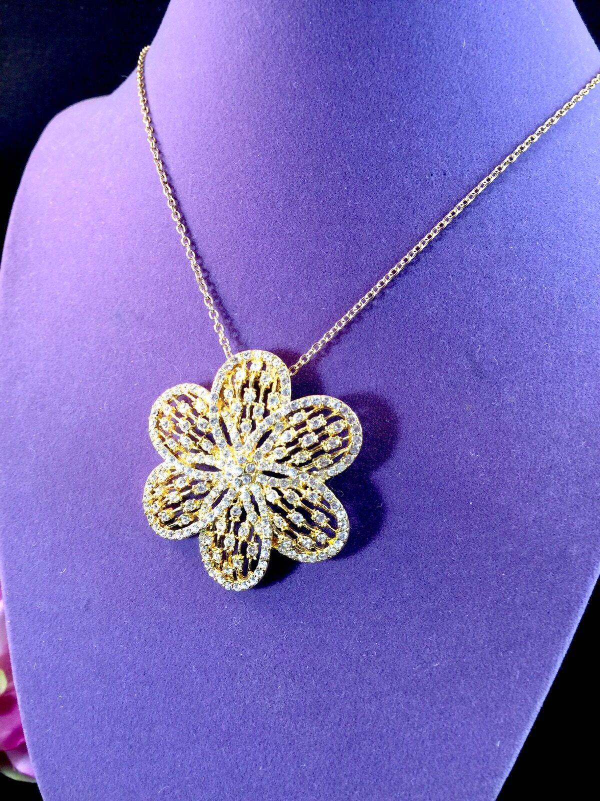 GORGEOUS NOLAN MILLER GLOSSY gold-TONE CRYSTAL RHINESTONE SPIRAL FLOWER PENDANT