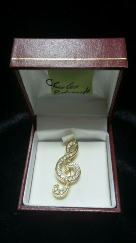 JOB LOT OF 24 BOXED COSTUME JEWELLERY GOLD PLATED TREBLE CLEF BROOCH MADE IN UK