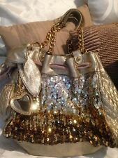 JUICY COUTURE GOLD SPARKLE SEQUENCE SHOULDER BAG WITH BOW ACCENT AND GOLD CHAINS