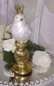 Dekofigur Vogel auf Zapfen 8cm gold